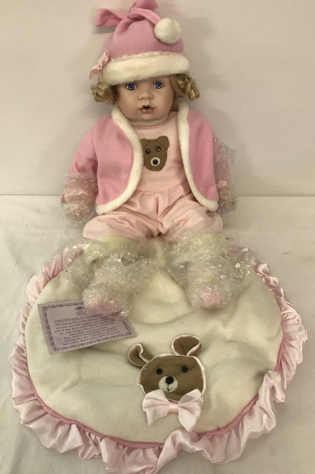 Lot 116 - A boxed Leonardo collection collectors baby doll with teddy bear blanket.