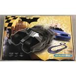A boxed Batman Begins slot cars Scalextric racing set.