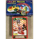 A boxed Berketex Crazy Train playset together with A DY Toy Santa moving toy.