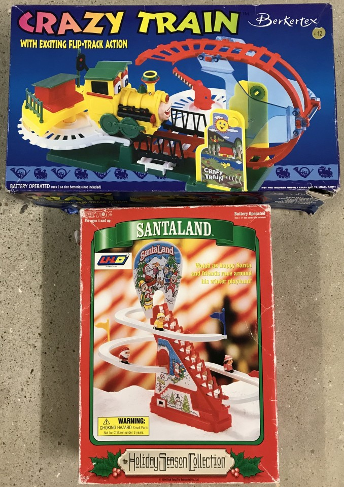 Lot 104 - A boxed Berketex Crazy Train playset together with A DY Toy Santa moving toy.