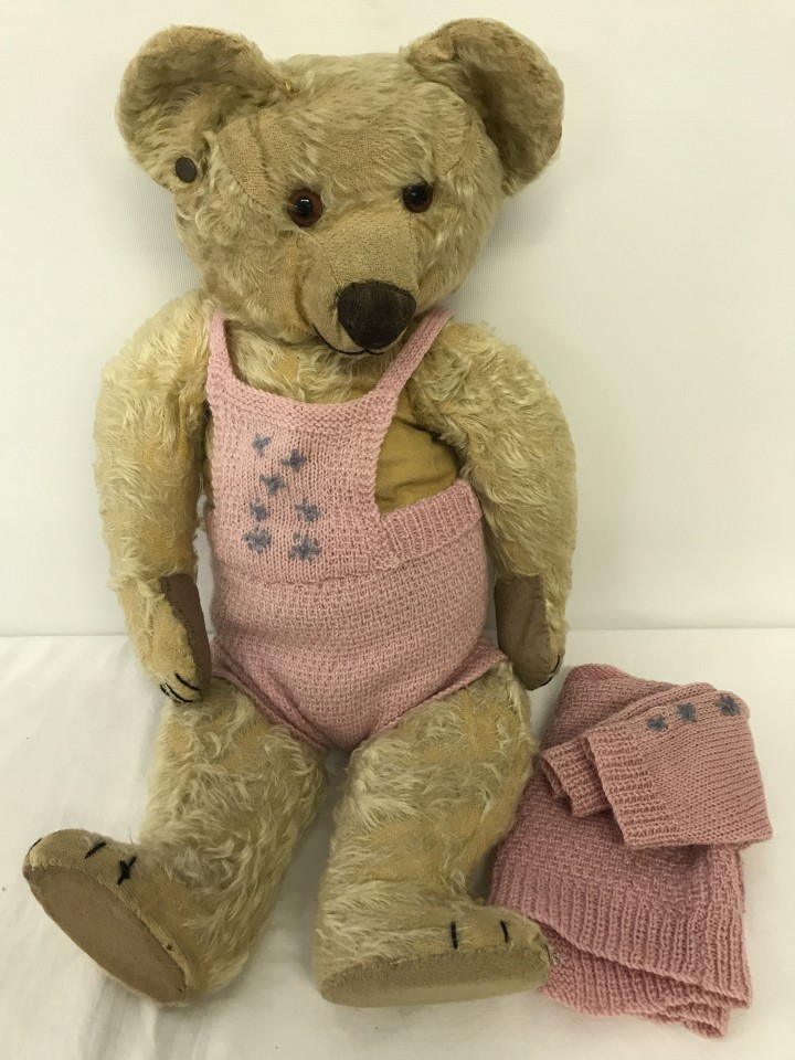 Lot 146 - A c1930's blond haired Chad Valley jointed Teddy Bear with knitted outfit.