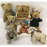 A collection of vintage teddies and other items.
