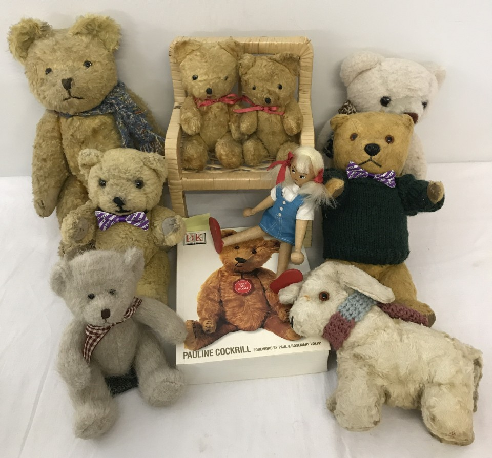 Lot 143 - A collection of vintage teddies and other items.