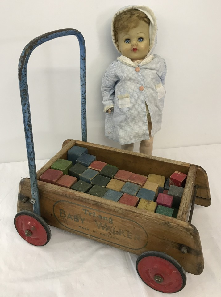 Lot 102 - A vintage Tri-ang Baby walker with coloured wooden bricks, & a vintage 'walker' doll.
