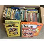 A box of vintage Enid Blyton books.