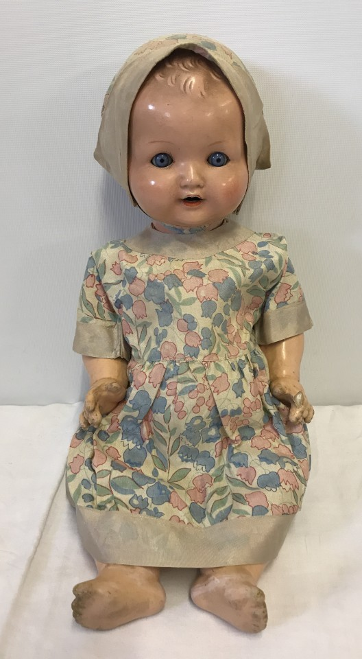 Lot 118 - An Armand Marseille composite baby doll with vintage silk dress and bonnet.