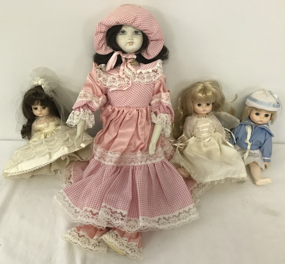 Lot 122 - 3 Effanbee, New York, dolls dated 1988 together with bisque headed doll in pink dress.