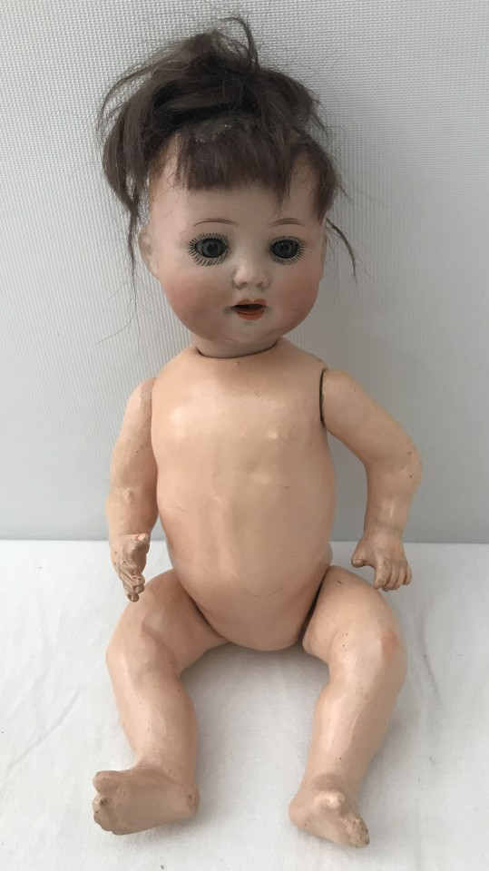 Lot 110 - A German bisque head girl doll by Porzellanfabrik Mengersgereuth.