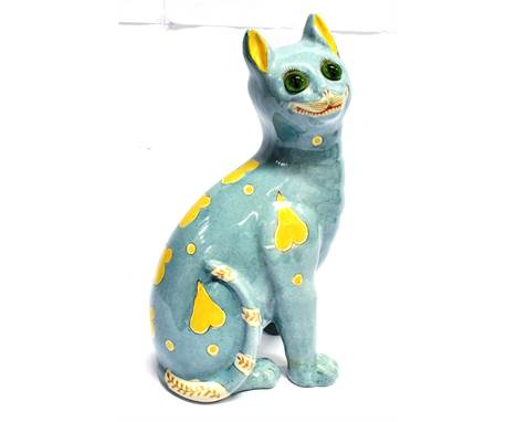 A FAIENCE POTTERY FIGURE OF A SEATED CAT IN THE MANNER OF GALLE unmarked but probably Mosanic, with green and black glass eye