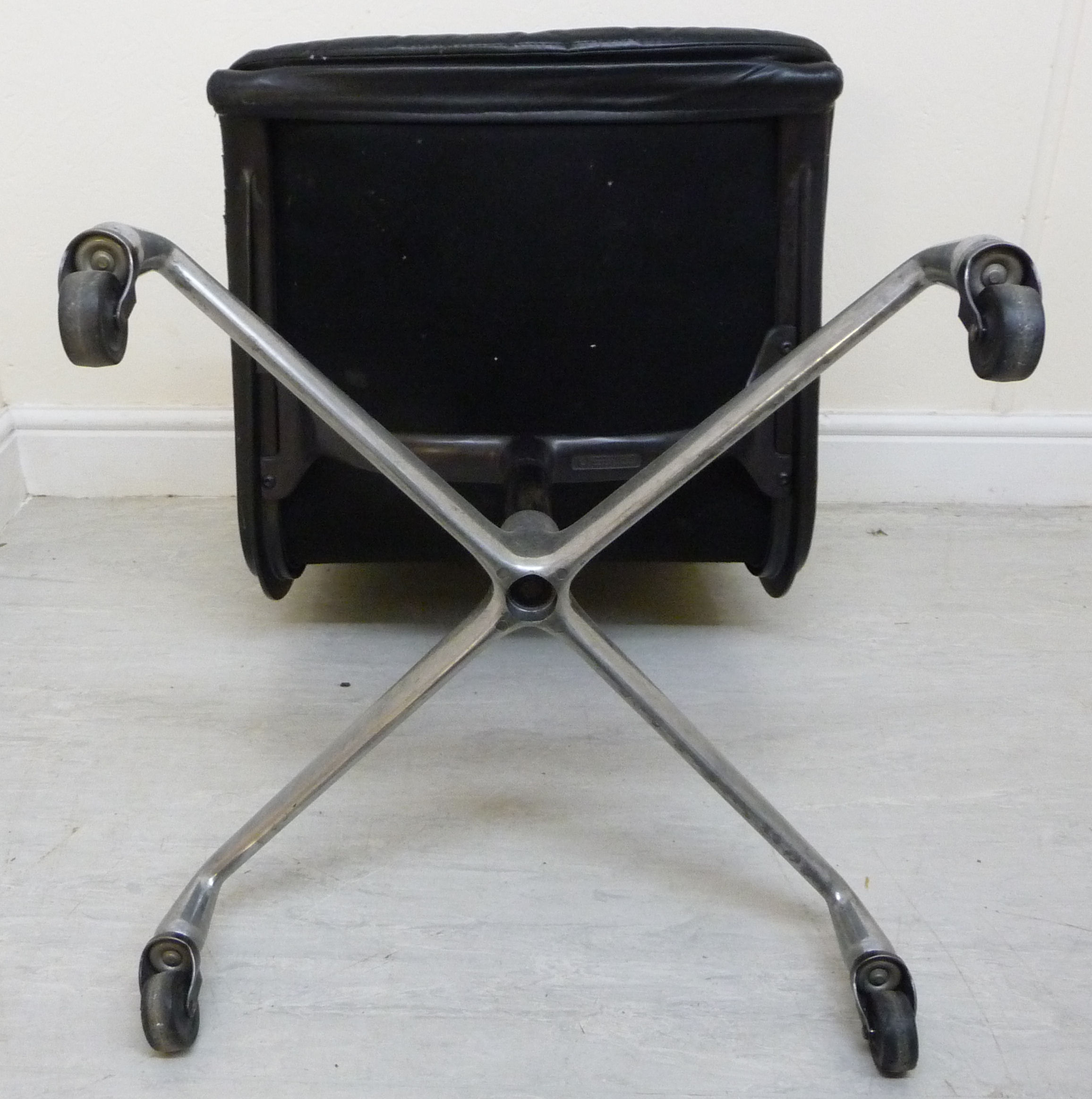 Lot 12 - A Herman Miller chair with a cushioned black hide upholstered back and seat,