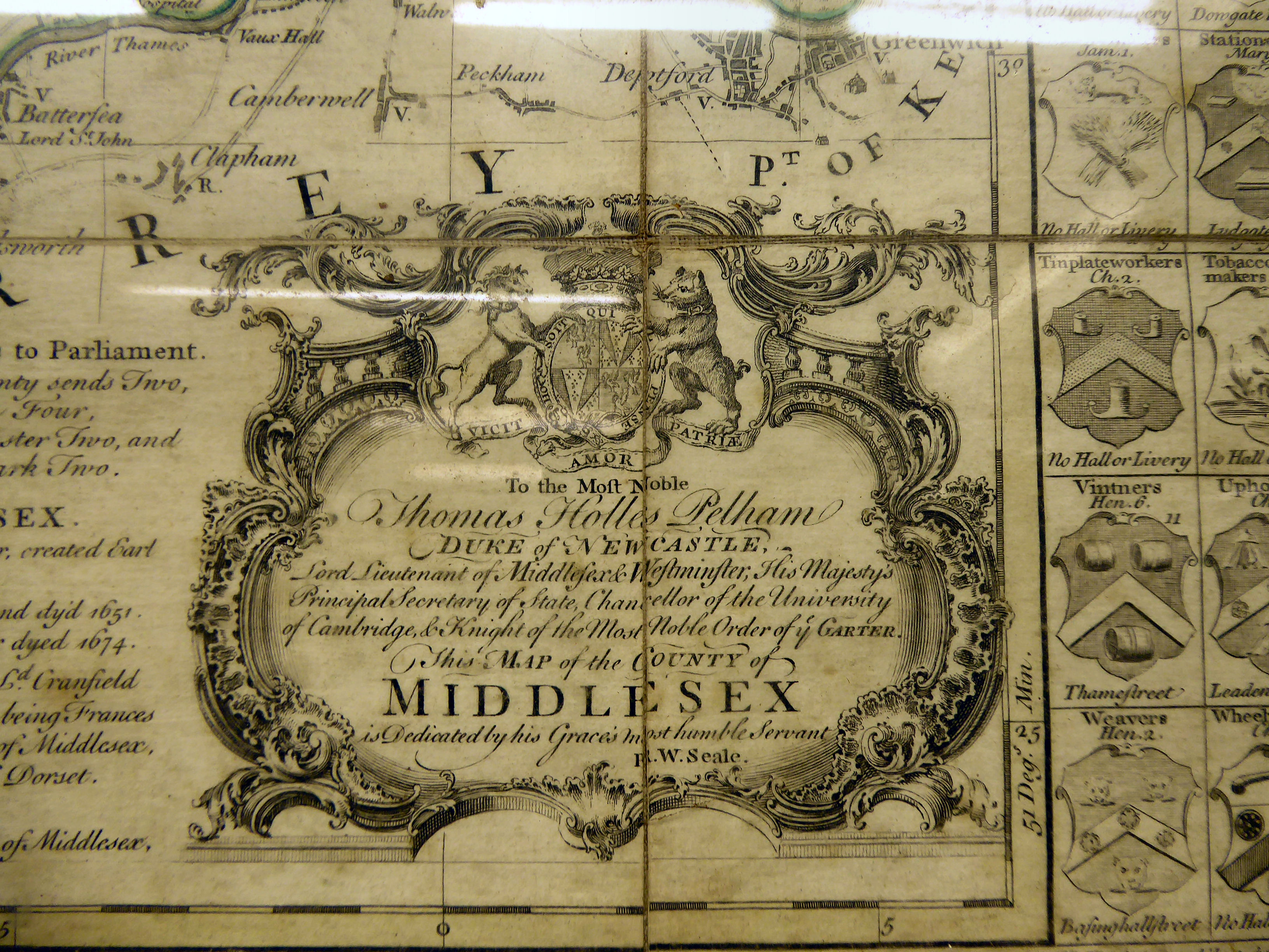 Lot 37 - An 18thC coloured line boundaried county map 'Middlesex' the decorative title cartouche inscribed