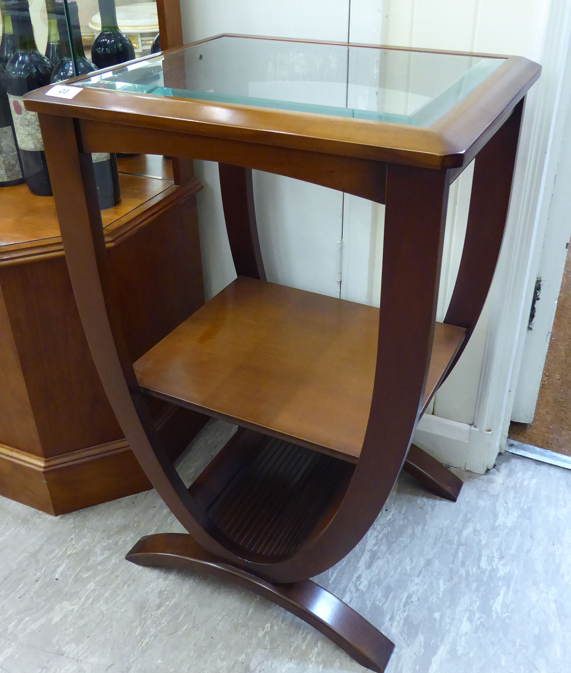 Lot 23 - A modern mahogany finished lamp table with an inset, clear bevelled mirror panel,