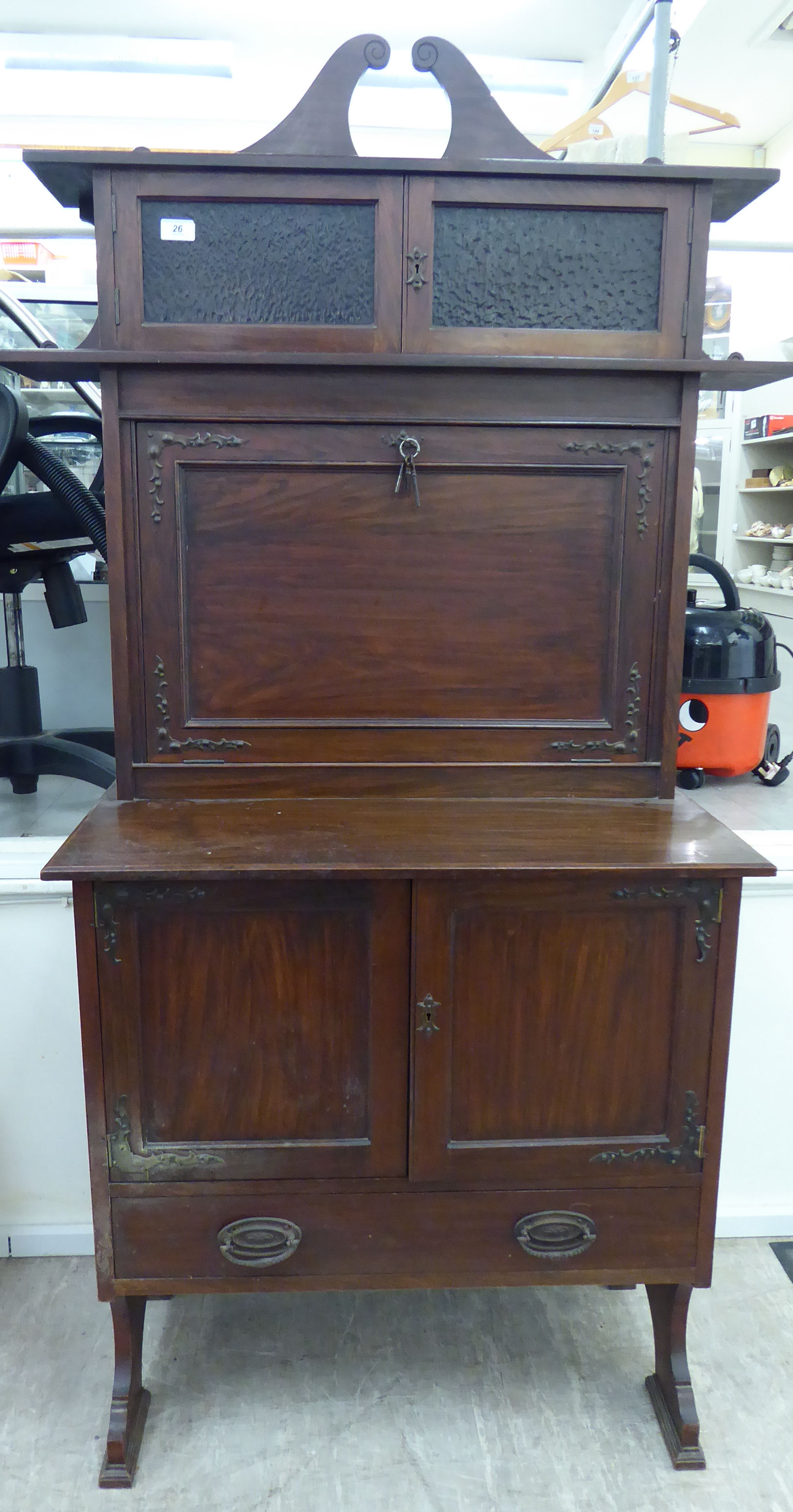 Lot 26 - An early 20thC mahogany and faux rosewood desk,