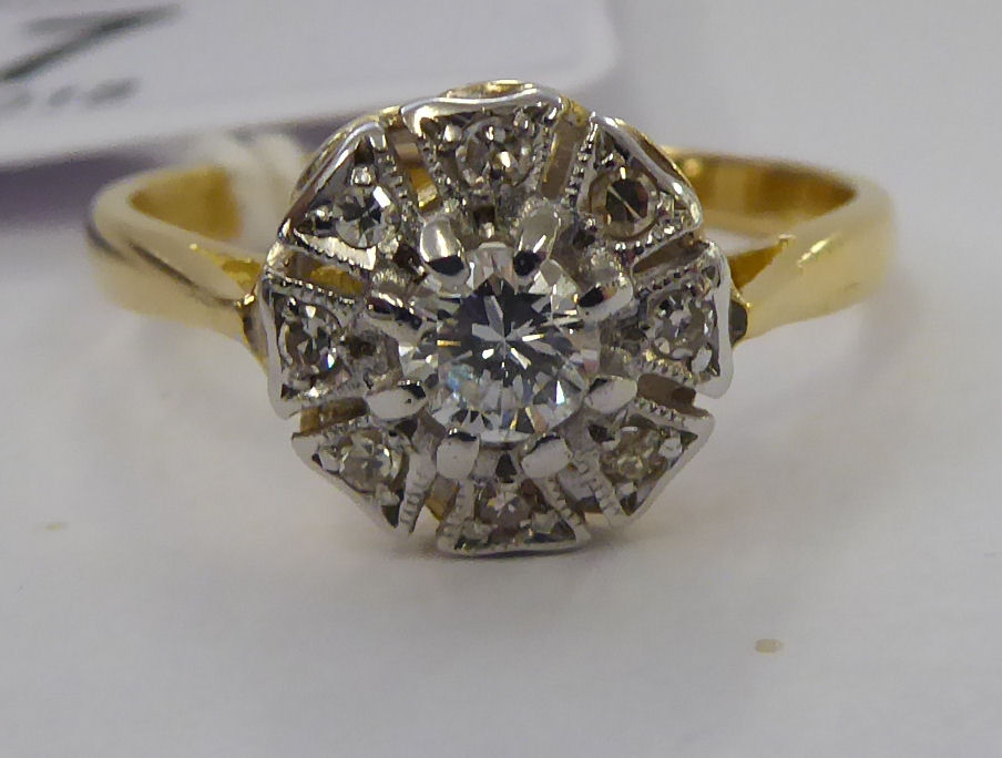 Lot 27 - An 18ct gold diamond cluster ring 11