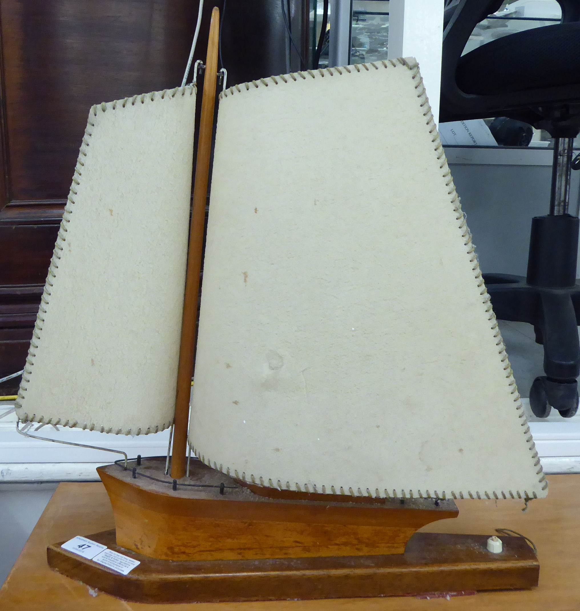 Lot 47 - A mid 20thC novelty table lamp,