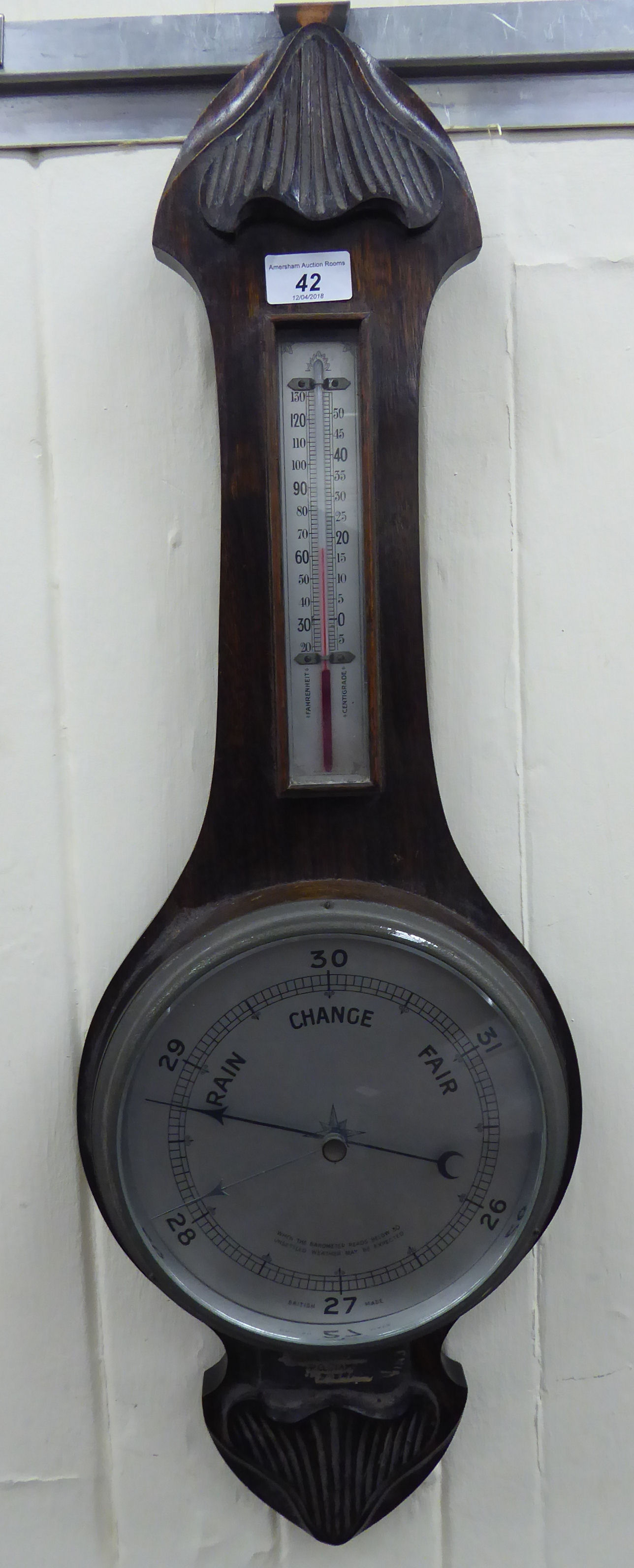 Lot 42 - An early 20thC aneroid barometer, incorporating a thermometer,