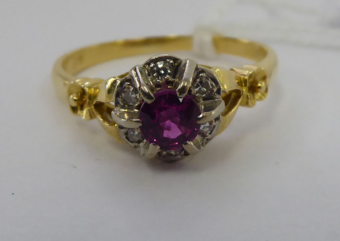 Lot 19 - An 'antique' 18ct gold ruby and diamond set cluster ring 11