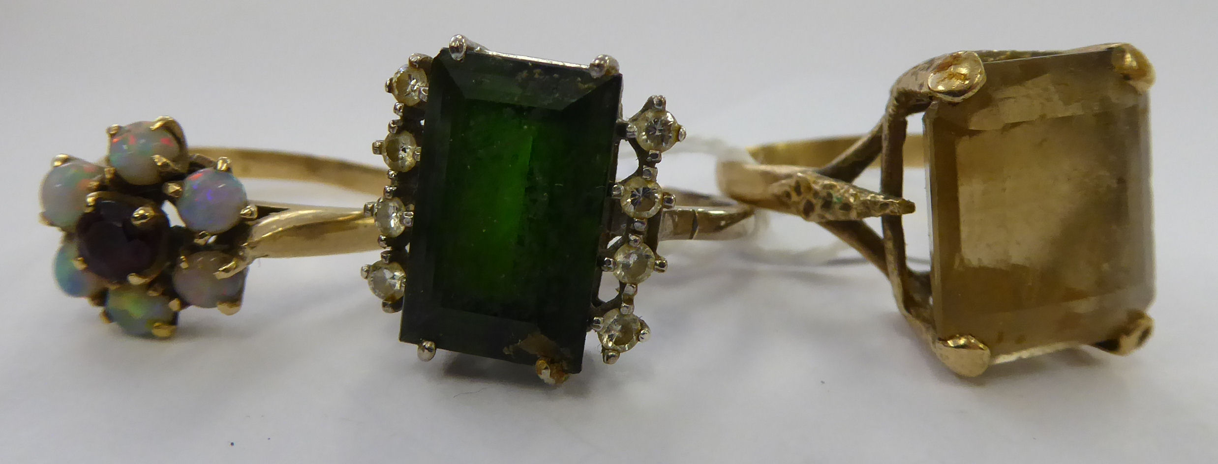 Lot 51 - Two yellow and one white metal dress rings,