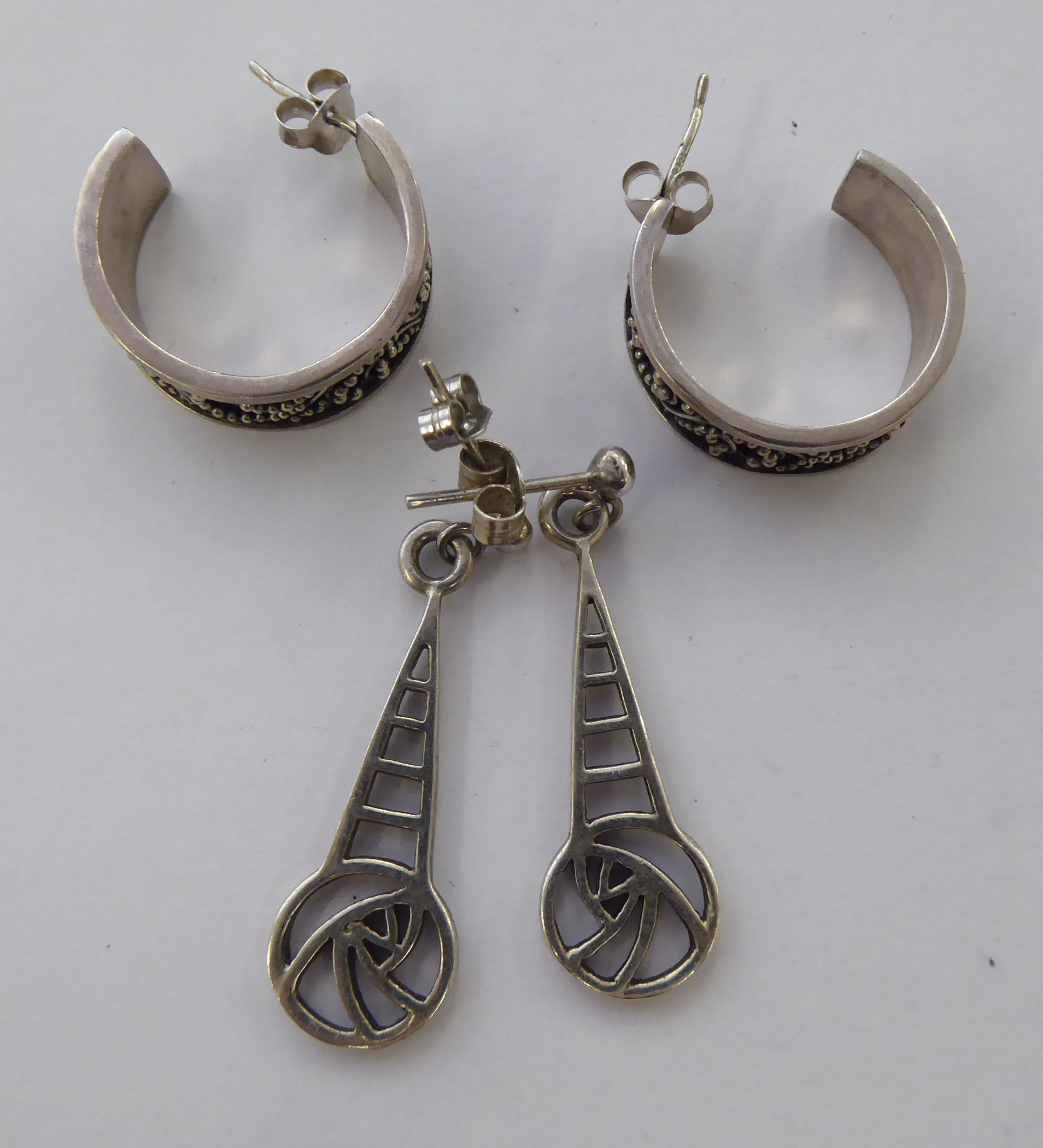 Lot 10 - Two dissimilar pairs of silver earrings 11