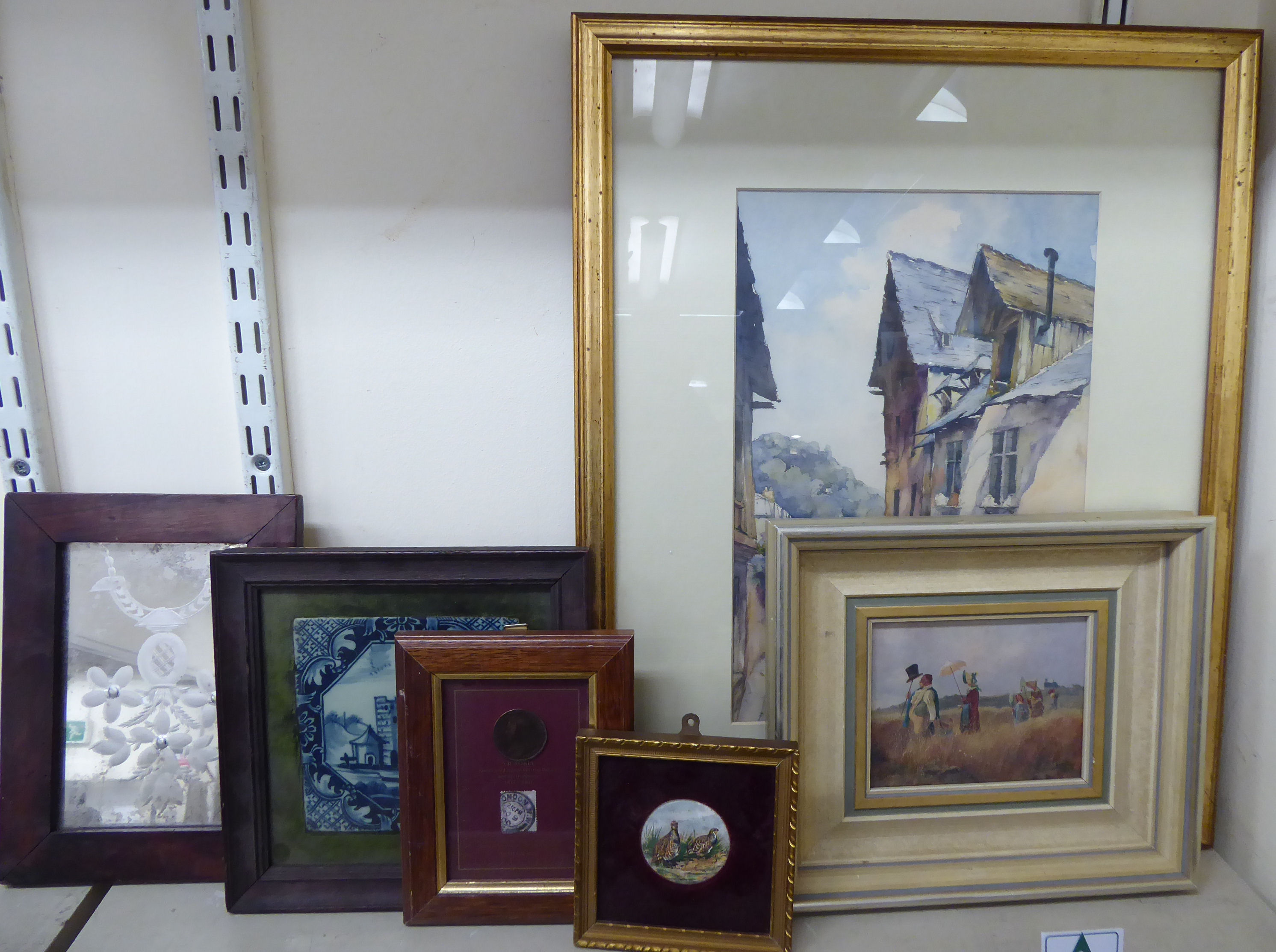 Lot 24 - Framed mixed media: to include a mid 19thC study of figures in a field 4'' x 5''; and a Delft tile,
