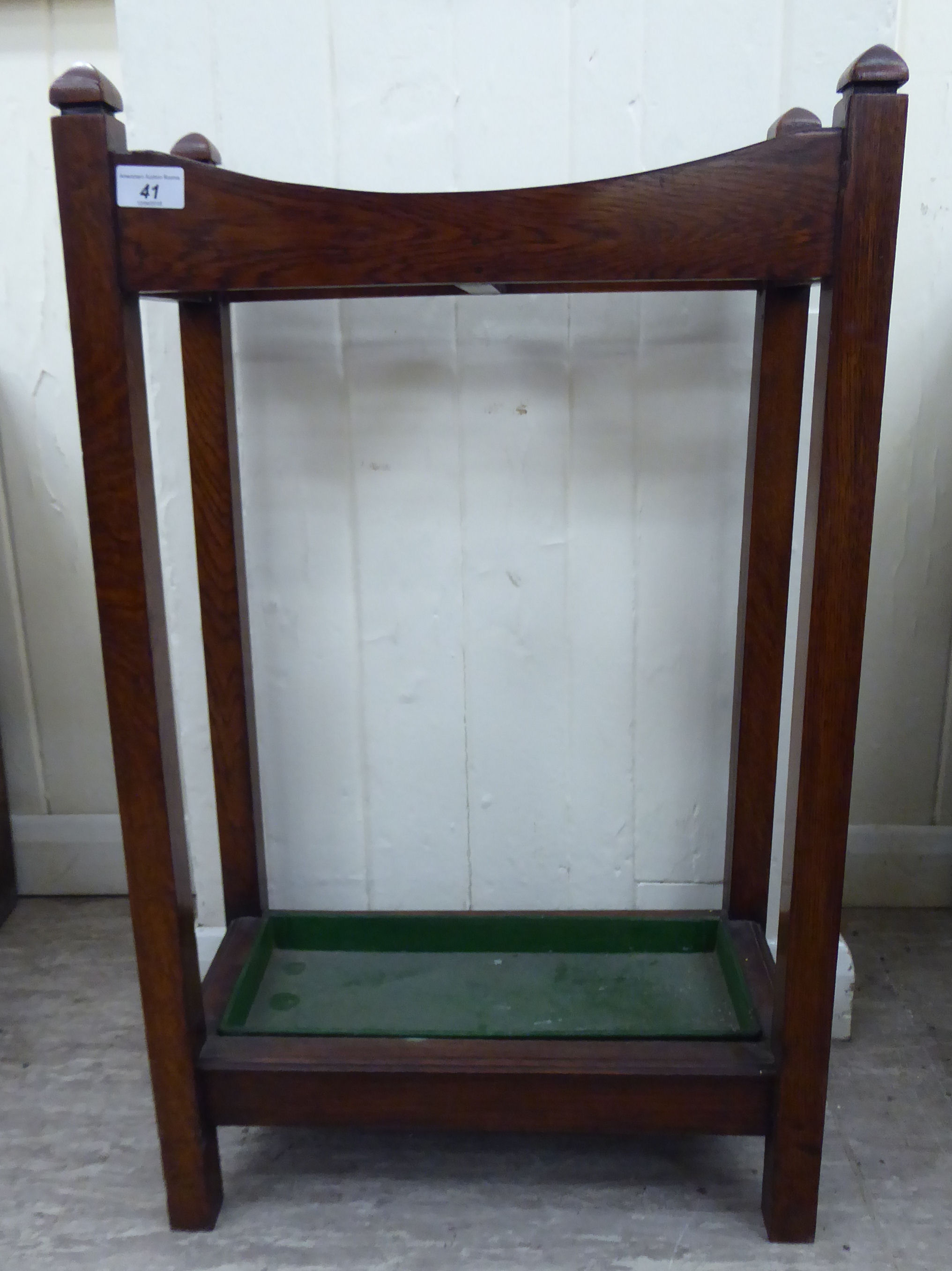 Lot 41 - A 1920s oak stickstand with a divided superstructure, on square supports,