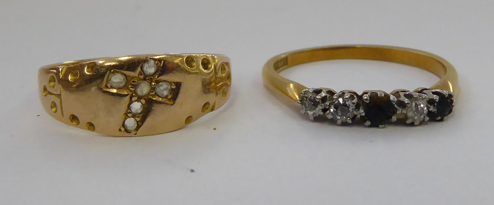 Lot 35 - A 15ct diamond set gold ring, featuring a cross; and an 18ct gold ring,