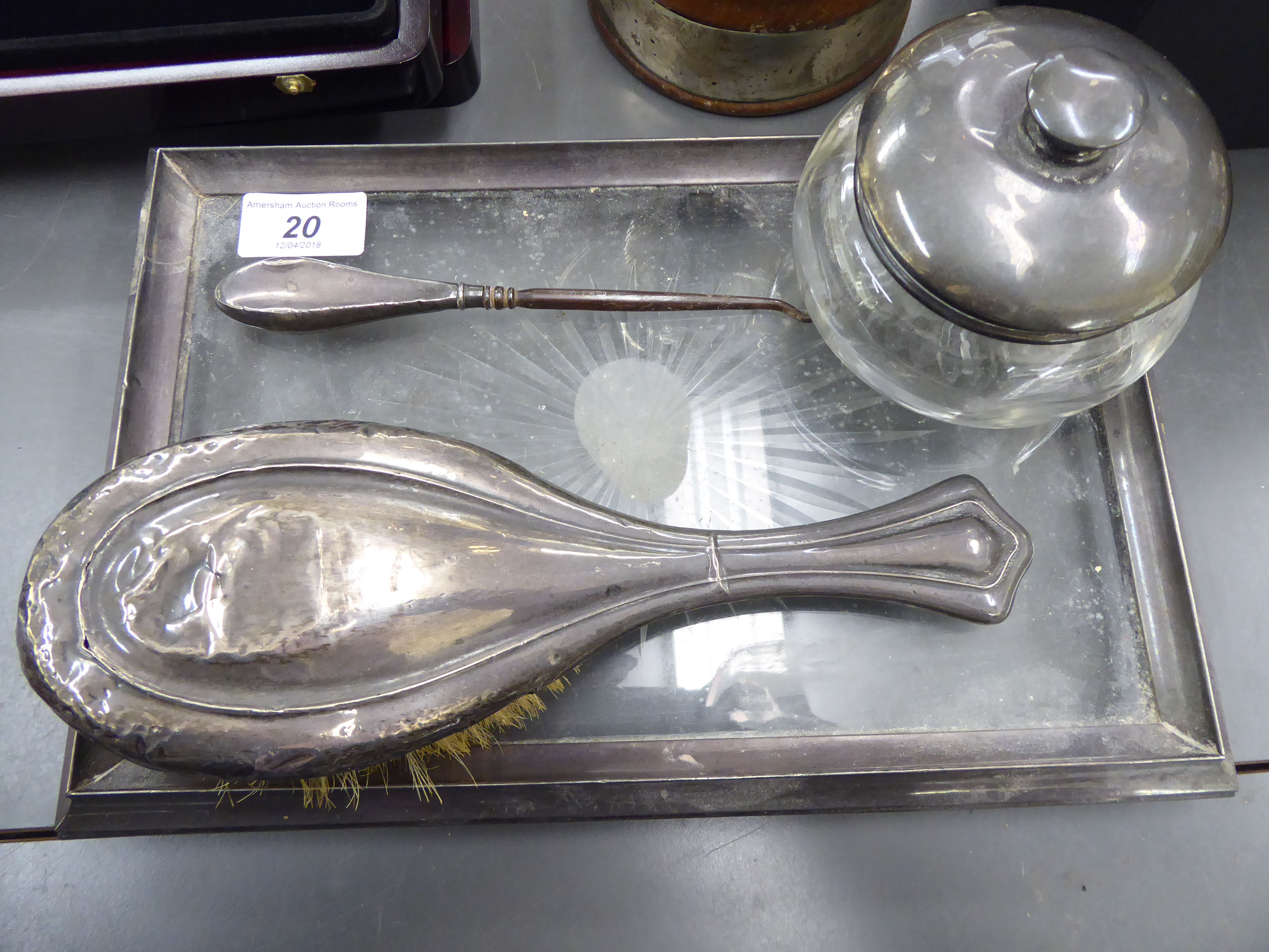 Lot 20 - An early 20thC silver framed dressing table tray with a cut-glass panel; a silver backed hairbrush;