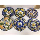 SIX LATE 19TH/EARLY 20TH CENTURY CONTINENTAL TIN GLAZED CHARGERS OF CIRCULAR FORM, EACH DECORATED