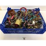 A LARGE ASSORTMENT OF VINTAGE COSTUME JEWELLERY INCLUDING NECKLACES, BANGLES AND MORE