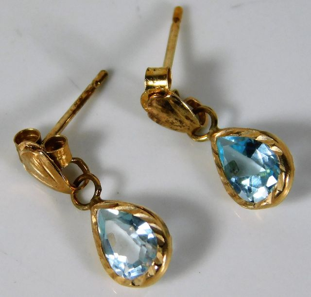 A pair of 9ct gold earrings set with topaz