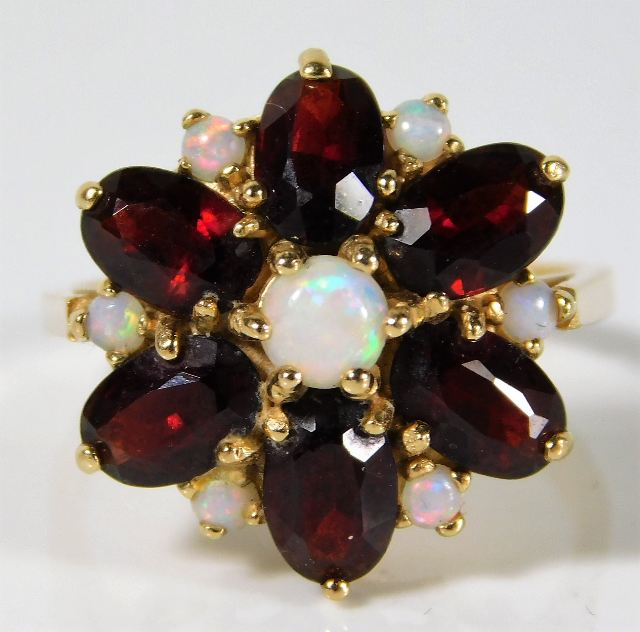 Lot 344 - A 14ct gold ring set with garnet & opal 5.1g size M