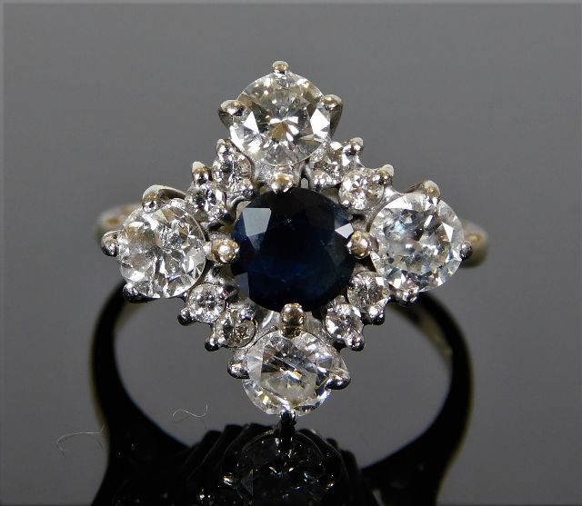 Lot 306 - An 18ct white gold ring set with sapphire & approx