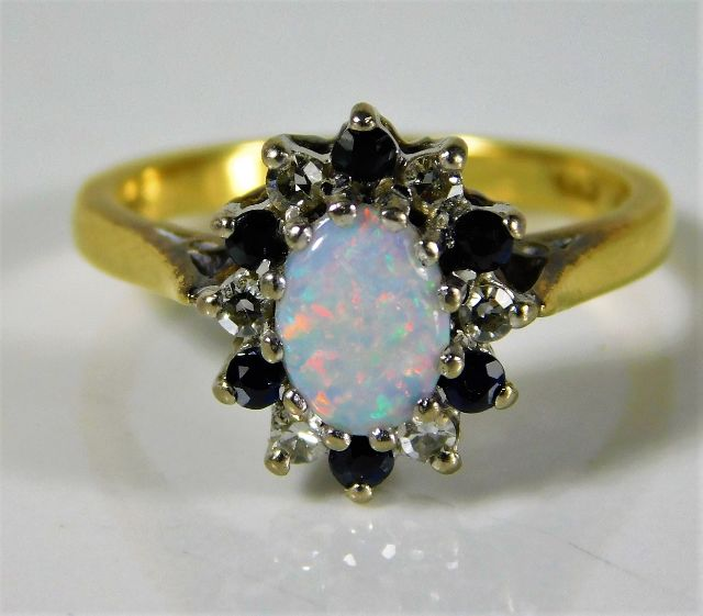 Lot 352 - An 18ct gold ring by B. Morris set with approx. 0.18ct diamond, sapphire & opal 3.8g size L