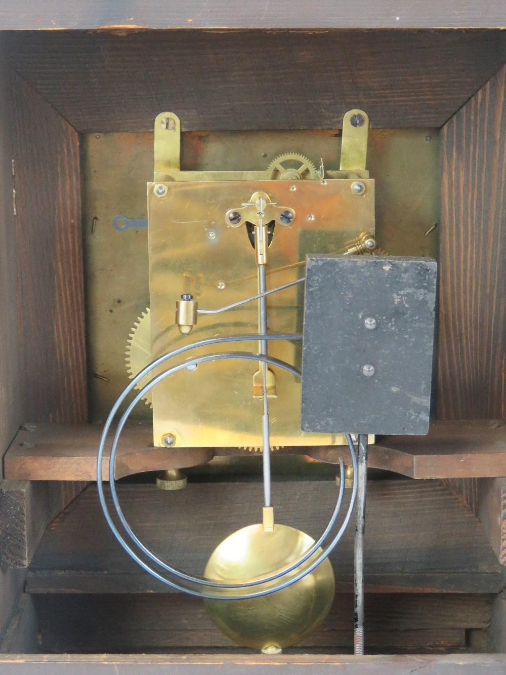Lot 351 - An Edwardian oak cased table clock, the