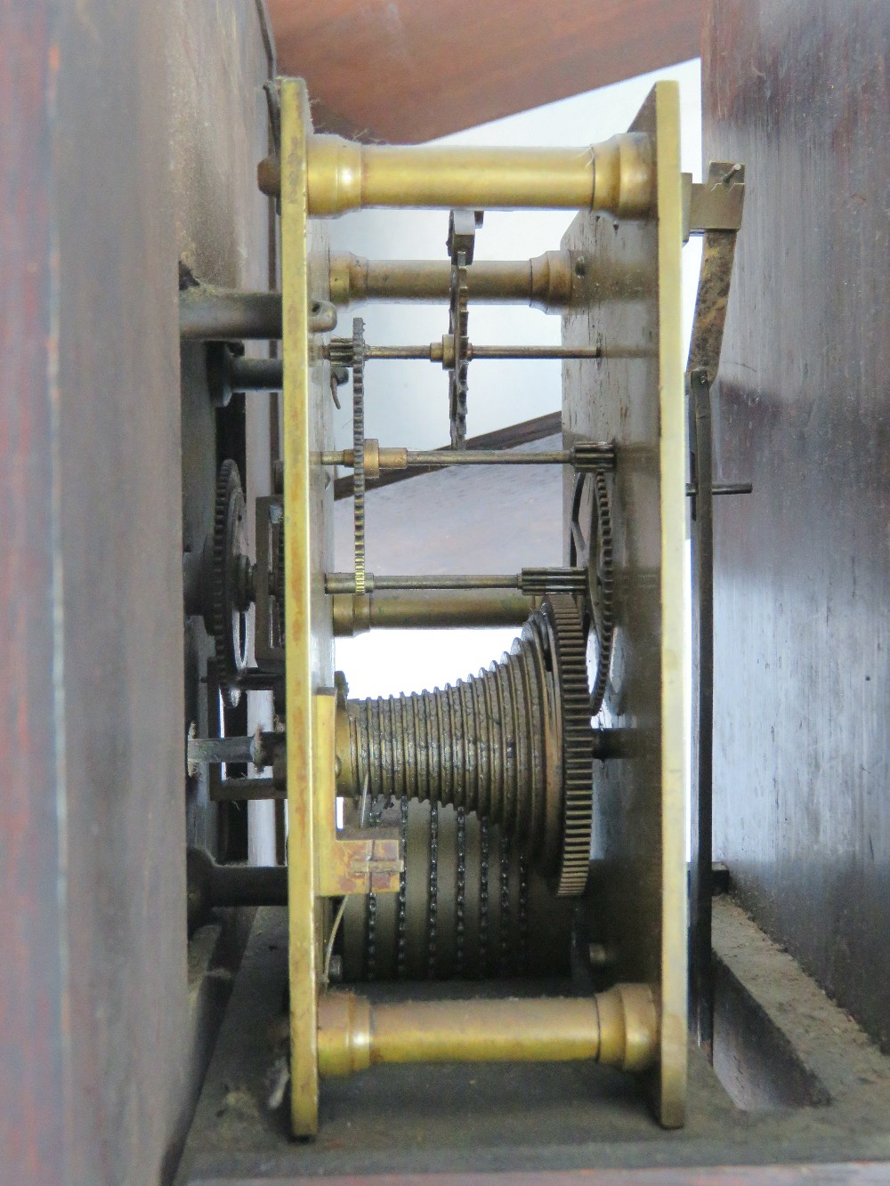 Lot 363 - A hooded wall clock of mahogany construc