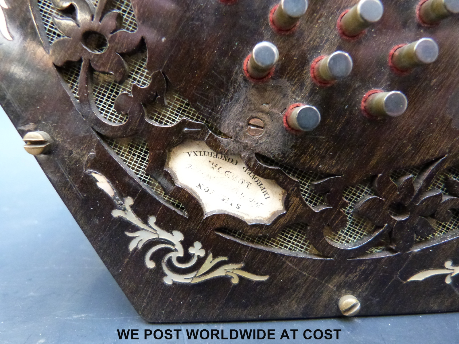 Lot 1248 - A mid nineteenth century English concertina with rosewood fretworked ends decorated with mother of