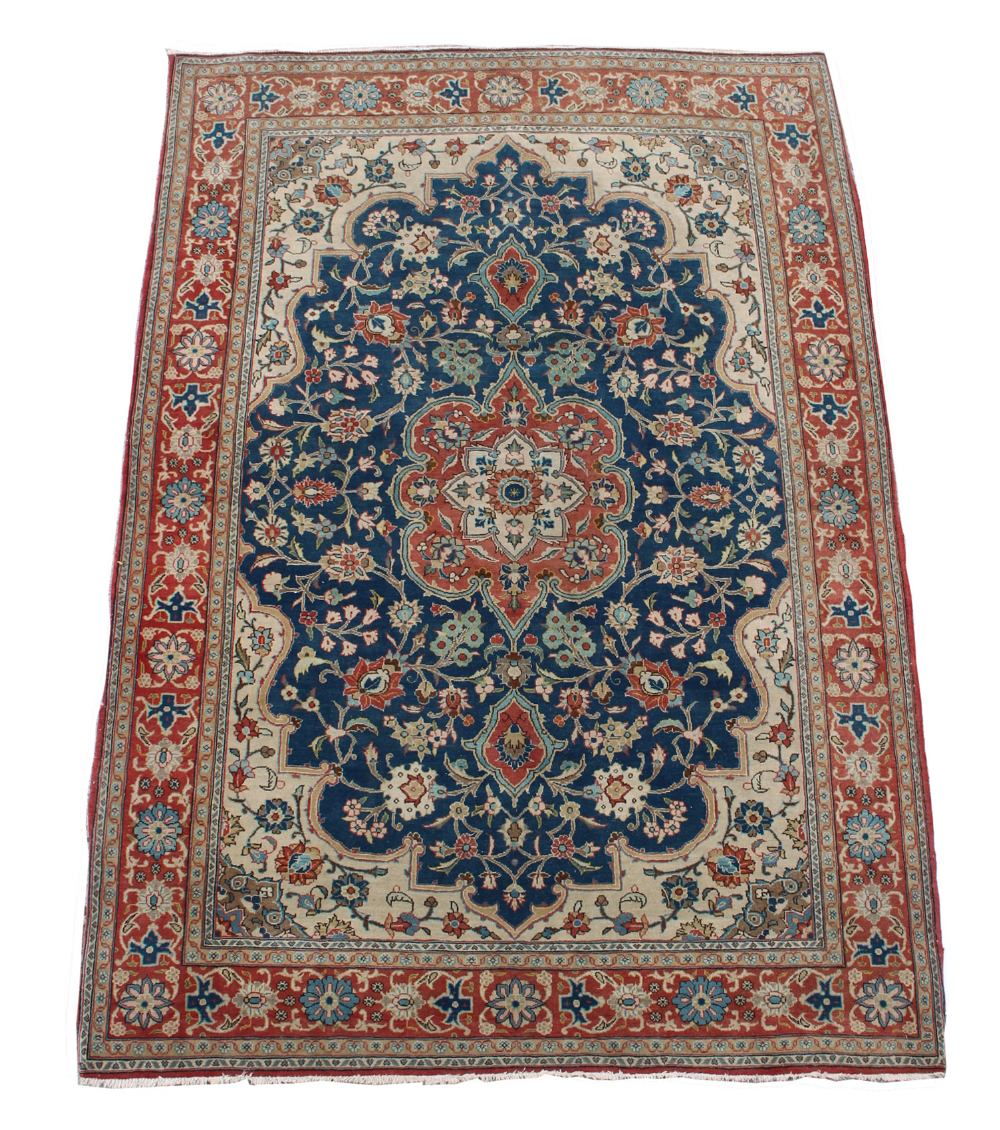 Lot 47 - An Isfahan rug, with navy field & ivory spandrels, 80 by 56ins. (202 by 153cms.).