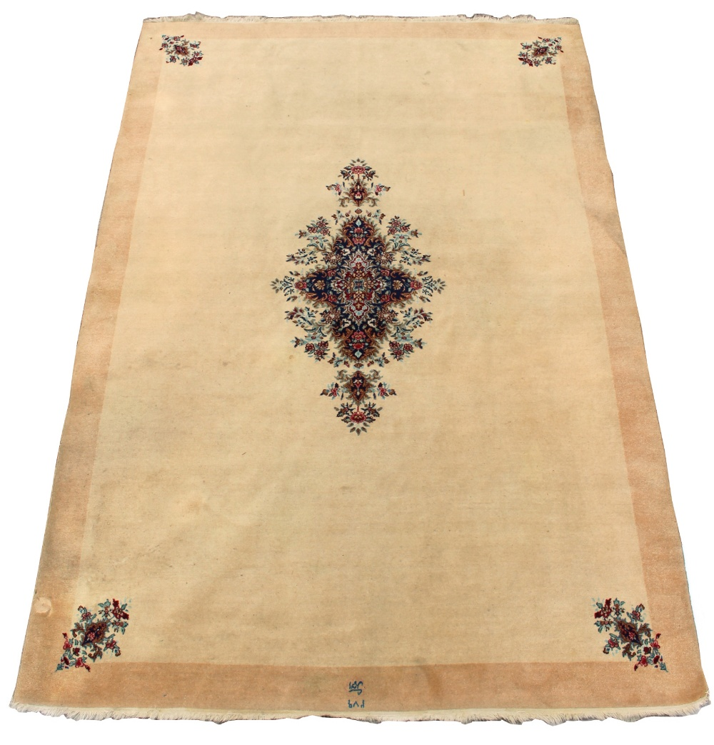 Lot 46 - Property of a deceased estate - a small Persian Qum carpet, with floral medallion & spandrels on