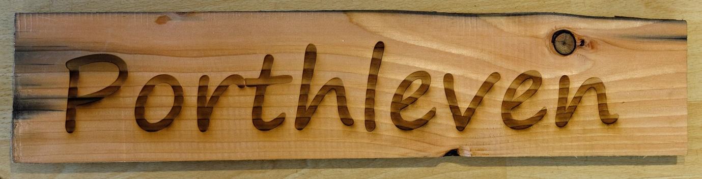 Lot 4 - Artist: Helston Community College Title: Porthleven sign Size: 12.5 x 56 x 2.5cm, 13 x 59.