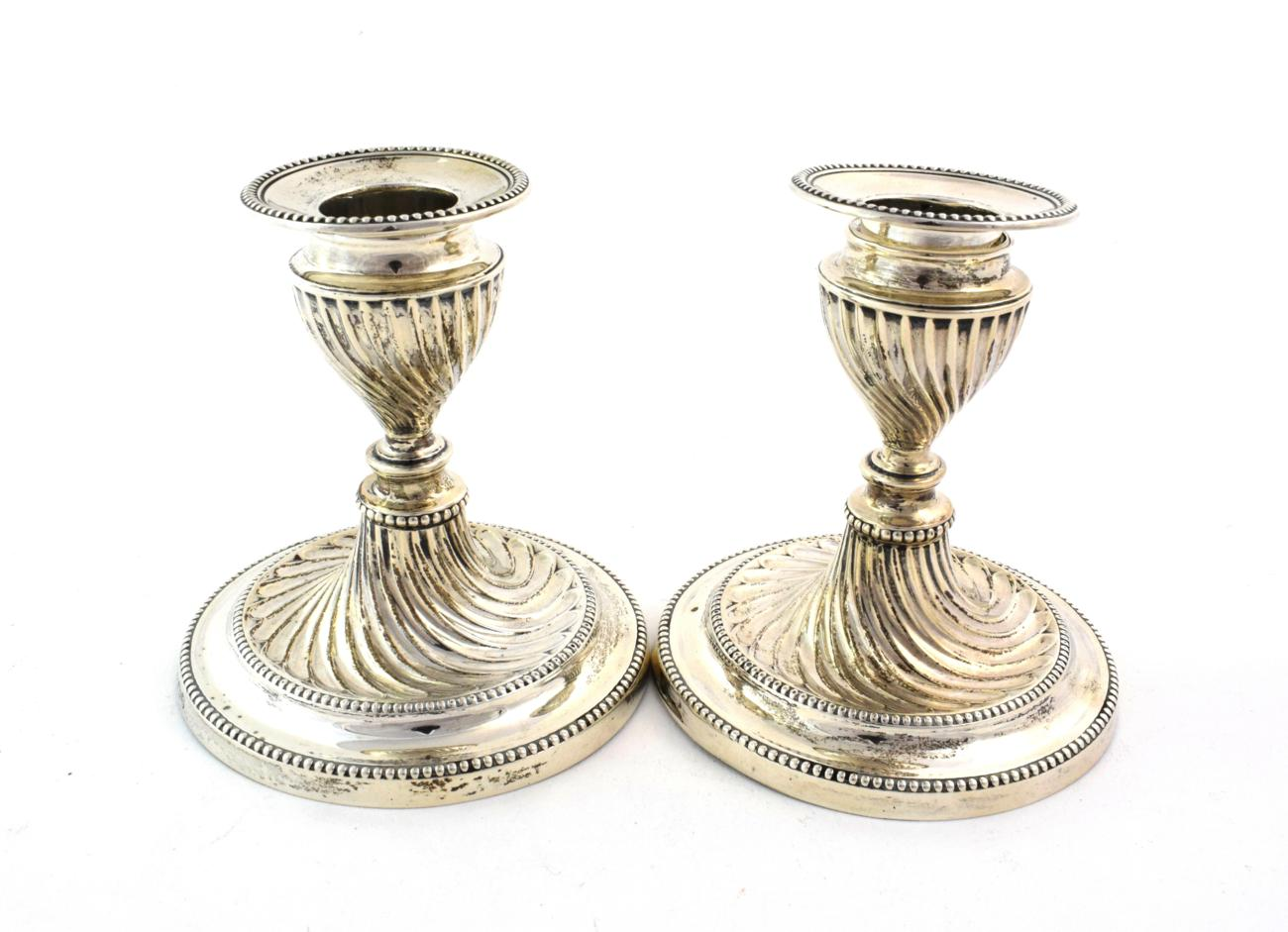 Lot 60 - A Pair of Victorian Silver Candlesticks, by Hawksworth, Eyre and Co, Sheffield, 1899, spirally-