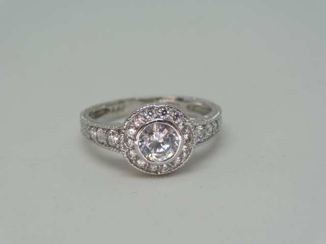 Ring Halo design ring with high grade cubic zirconia 10k white gold Size: N 1/2 .