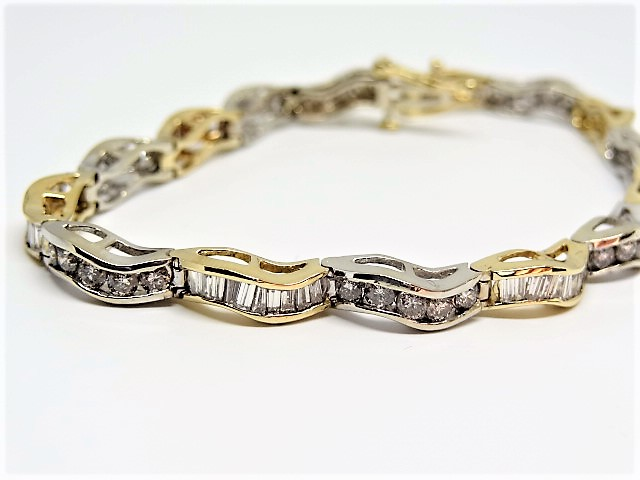 Lot 45 - 14k yellow and white gold Tennis bracelet 4ct