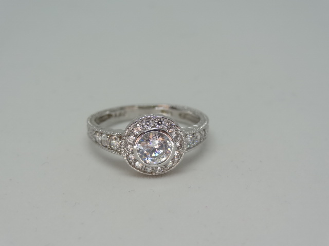 Lot 4 - Ring Halo design ring with high grade cubic zirconia 10k white gold Size: N 1/2 .
