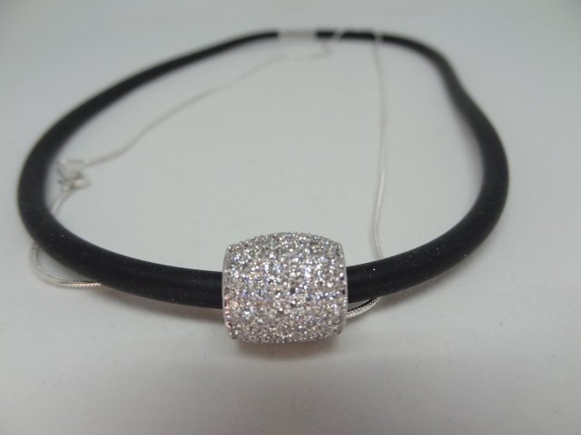 Lot 20 - Pave Diamond charm in a tube/barel shape. Charm is in 18kt white gold.