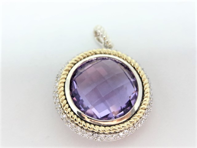 Pendant in 925 sterling silver and 14k yellow gold. 10.1 gr 2 row halo of pave diamonds, approx. 100