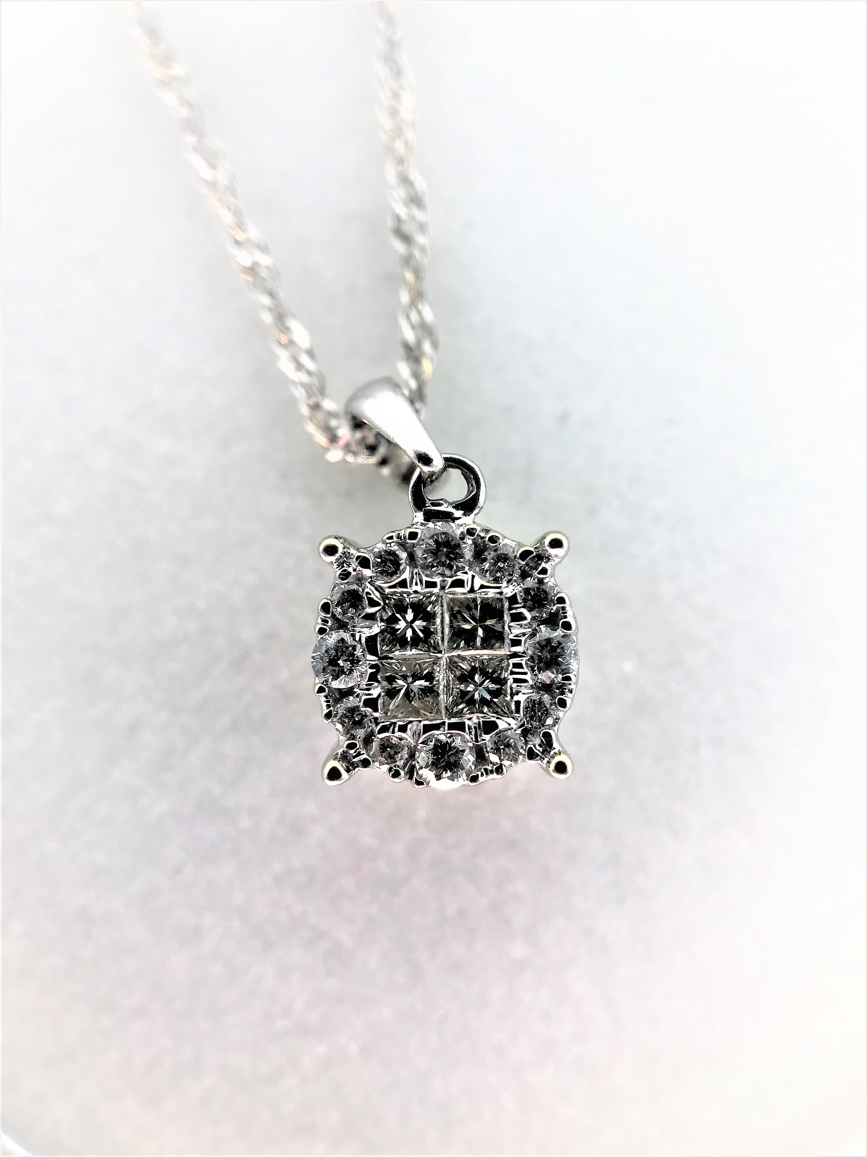 "14K white gold 18"" chain. Total diamond weight approx.: 0.25 CT."