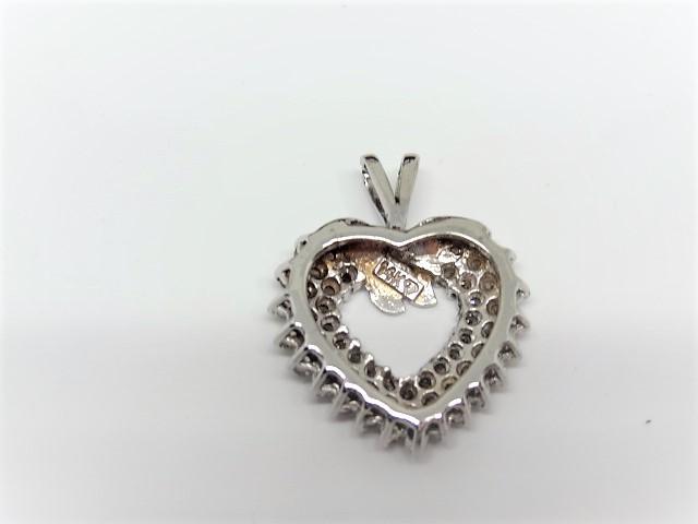 Lot 7 - Diamond heart pendant in 14k white gold. Approx. 55 diamonds.