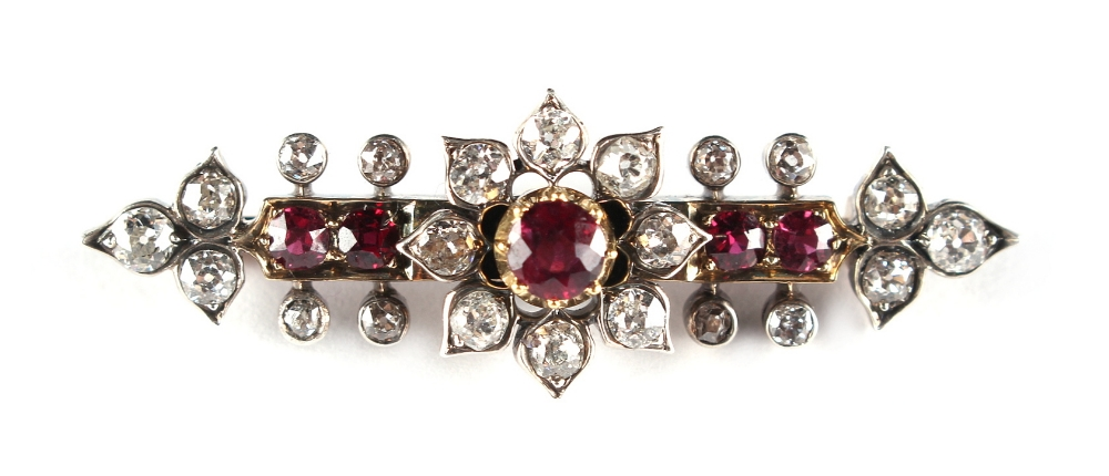 Lot 253 - A late 19th / early 20th century ruby & diamond brooch with centre flowerhead, set with five
