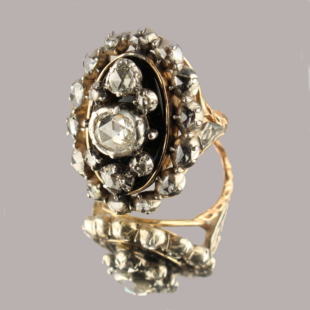 Lot 249 - A Georgian diamond & black enamel ring, with rose cut diamonds in oval setting with closed back,