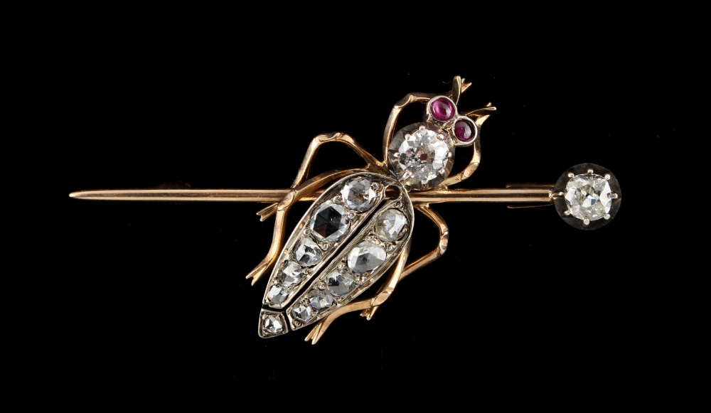 Lot 240 - An unmarked gold diamond bug brooch, set with two Old European cut diamonds, eleven graduated rose